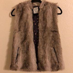 Amazing faux fur vest with a hood